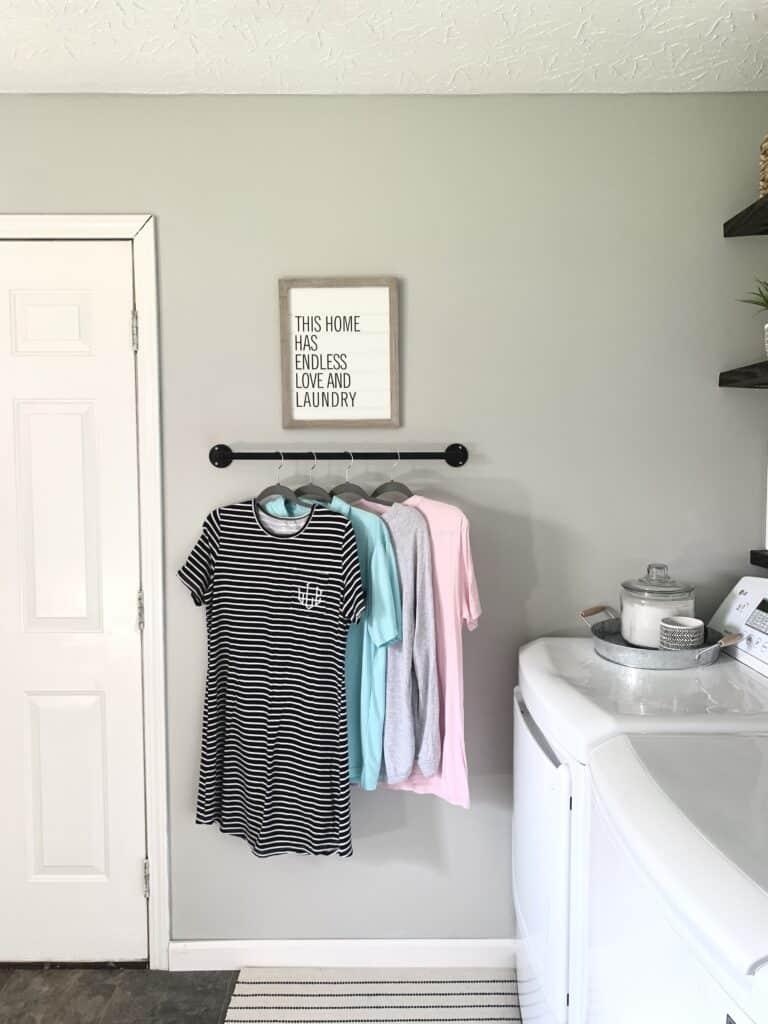 Laundry room hanging bar