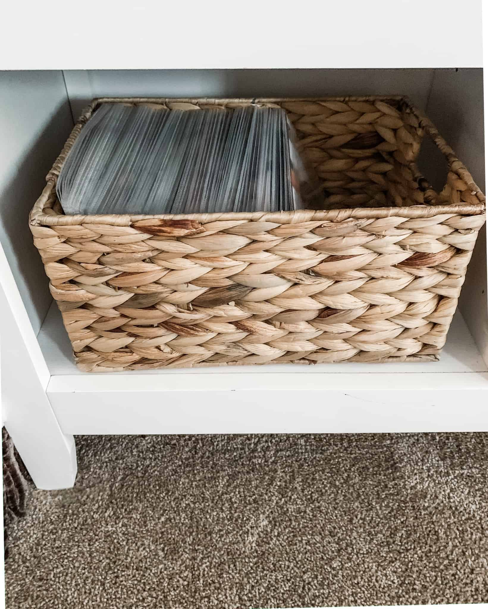 DVDs stored in a basket in sleeves for a DVD storage idea
