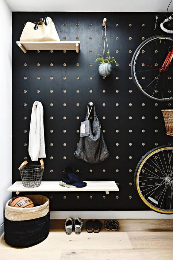black wall pegboard organization