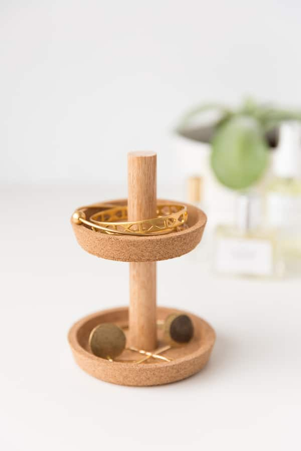 A DIY cork jewlery stand made from 2 Ikea coasters and a dowel